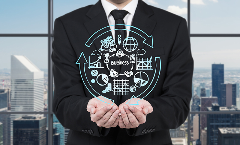 Man in a business suite holding business development cycle infographic in his hands
