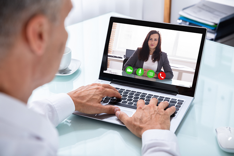 Business man and business woman video conferencing