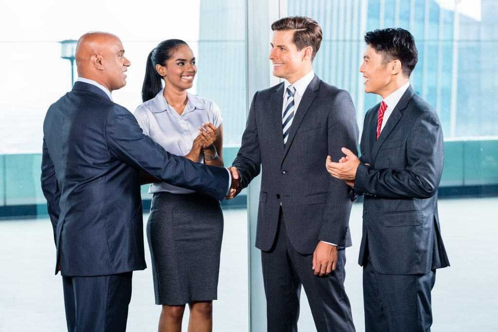 Business people in suits shaking hands